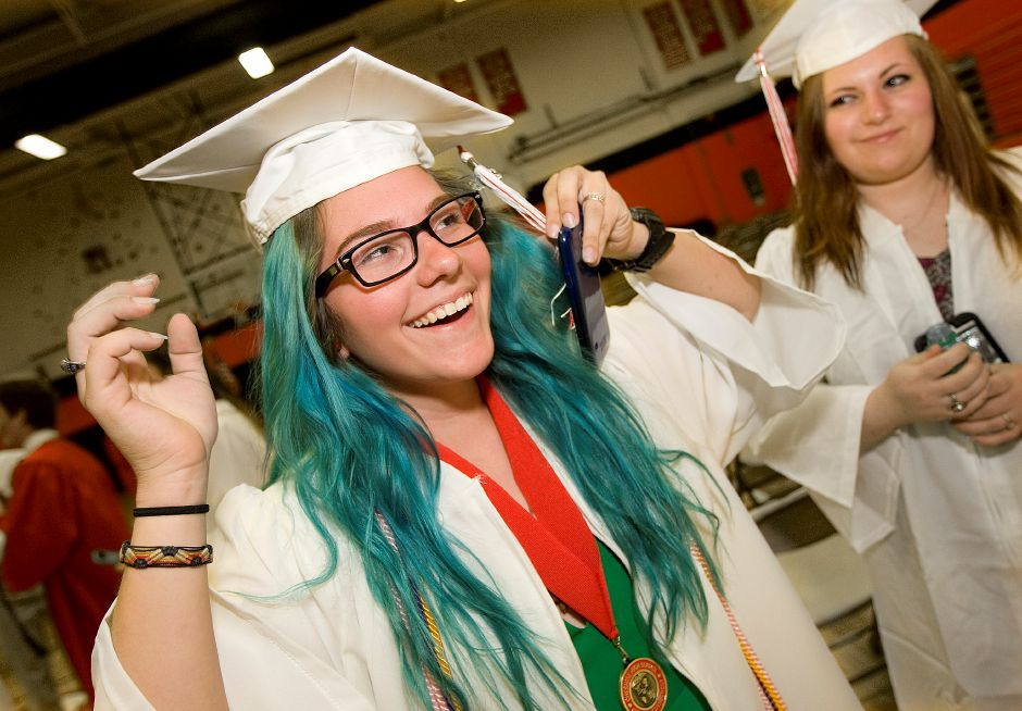 Laura Romaniello, 18, left, adjusts her cap next to friend, Shoshana Moskowitz, 18, right, before the start of graduation ceremonies at Cheshire High School, Friday, June 10, 2016. | Dave Zajac, Record-Journal