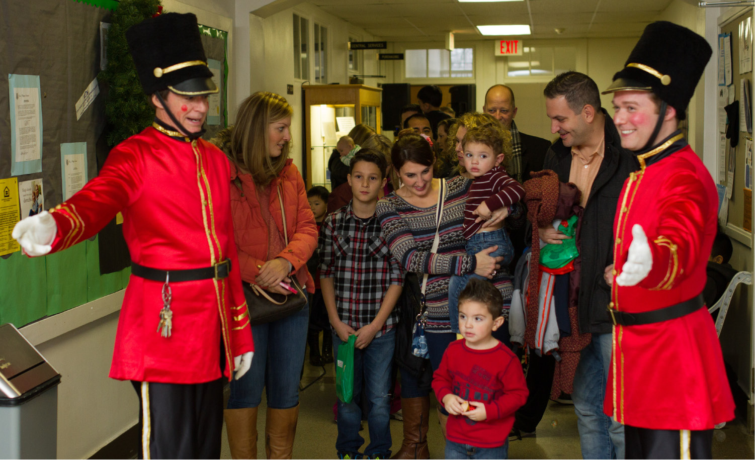 Mayor William W. Dickinson Jr., left, and Sam Carmody, dressed as toy soldiers, lets a family pass through to take photos with Santa Claus during the annual Seasons of Celebration in Wallingford, Dec. 6, 2014. | Eric Vo / Record-Journal