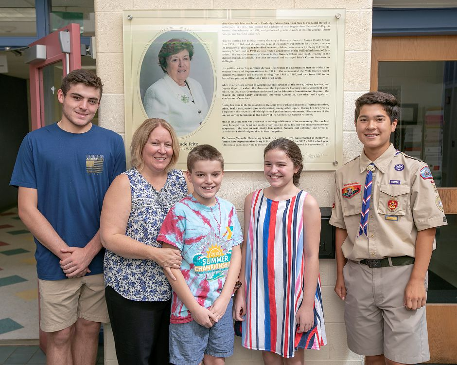 The family of Mary G. Fritz, left to right, Jack McDonnell, 15, Heather McDonnell, Cole McDonnell, 10, and Mae McDonnell, 10, pose with Eagle Scout Kalen Boman, 14, far right, in front of the memorial plaque, Friday, August 31, 2018. Dave Zajac, Record-Journal