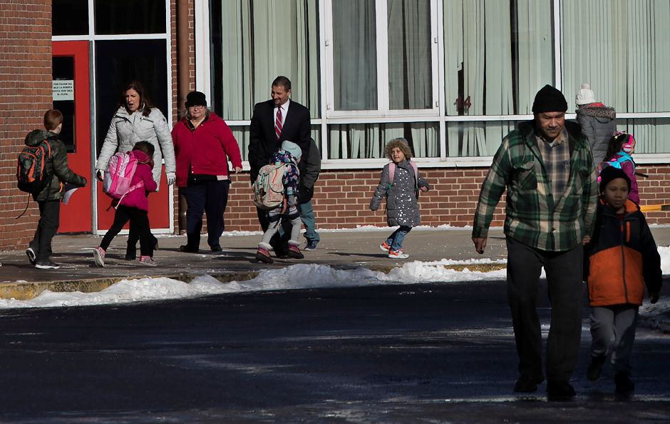 School Superintendent Mark Benigni, center, assists students during early dismissal at Hanover Elementary School in Meriden, Tuesday, Jan. 2, 2018. Dave Zajac, Record-Journal