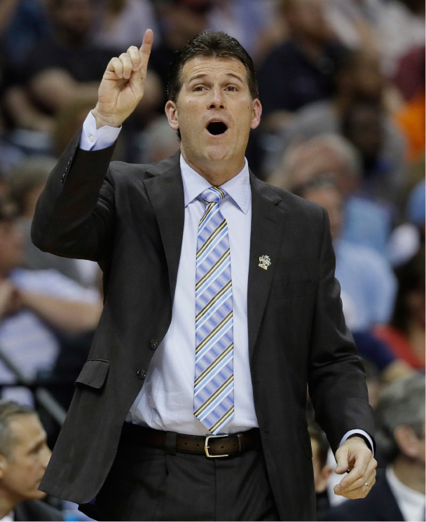 UCLA head coach Steve Alford speaks to players in the first half of an NCAA college basketball tournament South Regional semifinal game against Kentucky, Friday, March 24, 2017, in Memphis, Tenn. (AP Photo/Mark Humphrey)