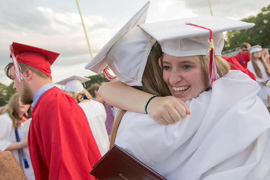 Graduate Gina Allegrini, 17, right, hugs friend and fellow graduate Kaeleigh Mahan, 17, at conclusion of graduation ceremonies at Cheshire High School, Thursday, June 21, 2018. Dave Zajac, Record-Journal