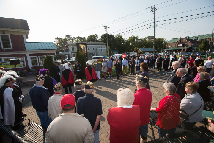 Southington residents gather at the Farmington Canal Heritage Trail 9/11 monument Monday in Plantsville during a 9/11 memorial remembrance ceremony on September 11, 2017 | Justin Weekes / For the Record-Journal