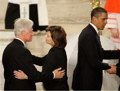 President Barack Obama right, with Pres. Bill Clinton, and widow Victoria Kennedy, greet during the peace portioin of the service at the Roman Catholic Funeral Mass for Sen. Edward M. Kennedy at Our Lady of Perpetual Help Basilica in Boston Saturday, Aug. 29, 2009.(AP Photo/Alex Brandon)