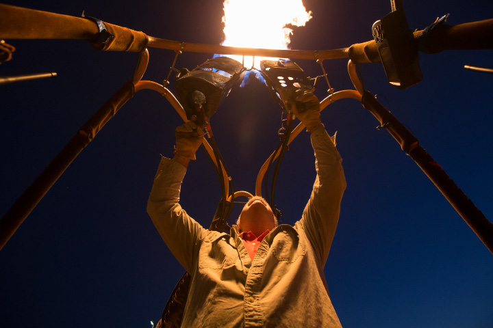 Robert Zirpolo, of Plainville, ignites the burners before setting up the balloon.