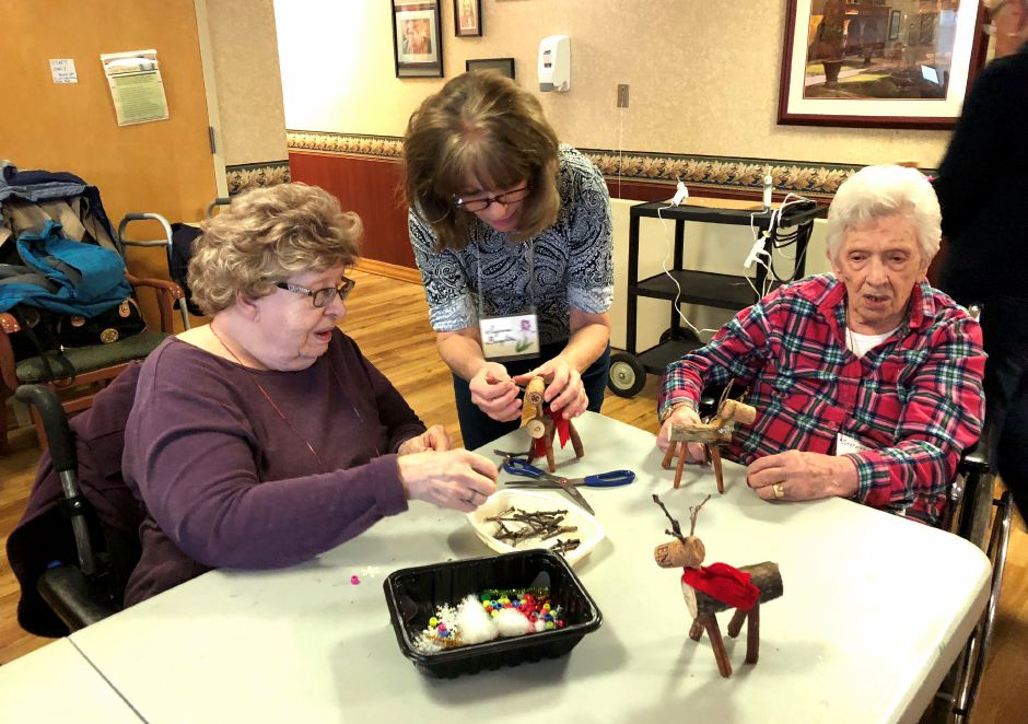 Peggy Smith, Sue Broughton of the Wallingford Garden Club, and JoJo DeLeonardis working on their reindeer.