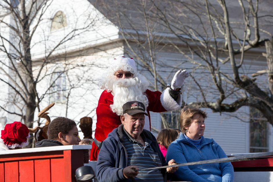 Sanat gets a ride on the horse drawn carriage Saturday during Christmas in the Village on Main Street in South Meriden December 1, 2018 | Justin Weekes / Special to the Record-Journal