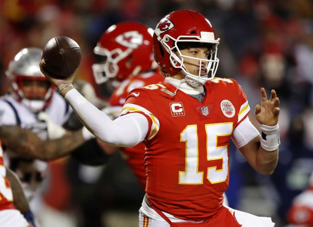 Kansas City Chiefs quarterback Patrick Mahomes (15) throws a pass during the second half of the AFC Championship NFL football game against the New England Patriots, Sunday, Jan. 20, 2019, in Kansas City, Mo. (AP Photo/Charlie Neibergall)