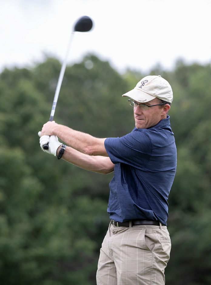 Stephen Johnson, of Canton, watches his drive on Hole #1 during the annual Hunter
