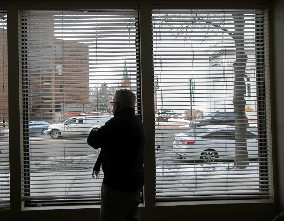 David Cooley, business consultant, looks out at Colony Street from the new Meriden Economic Development Corporation's office at 5 Colony St. in Meriden, Thursday, Feb. 1, 2018. Dave Zajac, Record-Journal