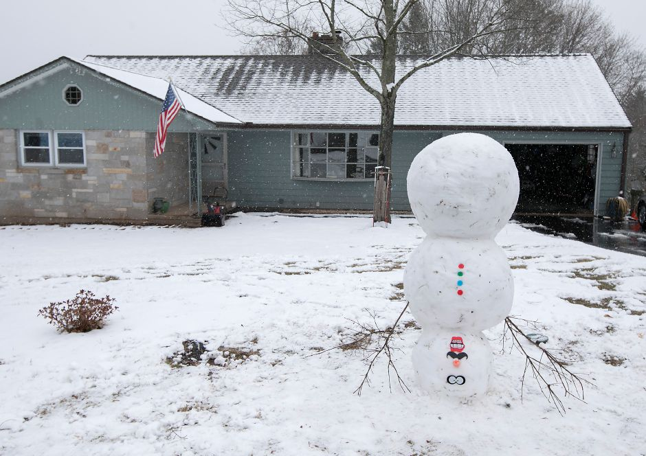 An upside down snowman made by Eddie Siebert and son, Zackary, 6, of Meriden, in front of their residence, Wednesday, Jan. 17, 2018. About two inches of snow accumulated in the area. Dave Zajac, Record-Journal