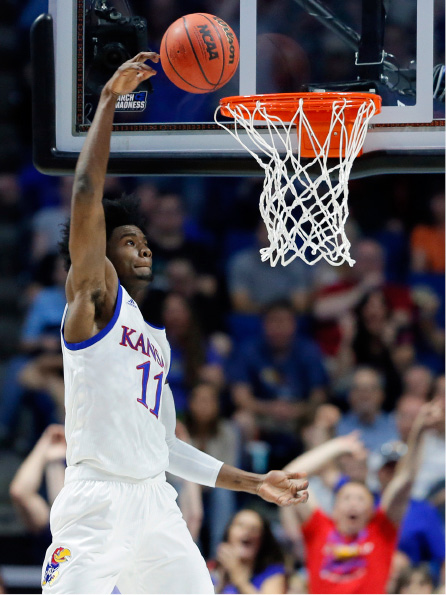 Kansas guard Josh Jackson (11) loses control of the ball on a dunk attempt, failing to make the basket, during the first half of a second-round game against Michigan State in the men