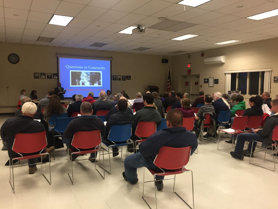Durham residents listen to the Board of Finance present its 2019-20 town budget proposal during a public hearing at the Volunteer Firehouse on Tuesday, April 9.