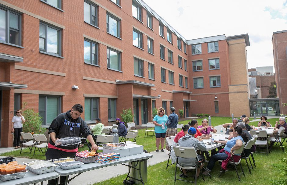 Luis Ortiz, 16, of Meriden, attends a cookout with other downtown residents in the courtyard behind 24 Colony St. in Meriden, Fri., May 24, 2019. Residents enjoyed a cookout with members of the police department and the NI unit as an ongoing effort to increase relationships between citizens and officers. Dave Zajac, Record-Journal