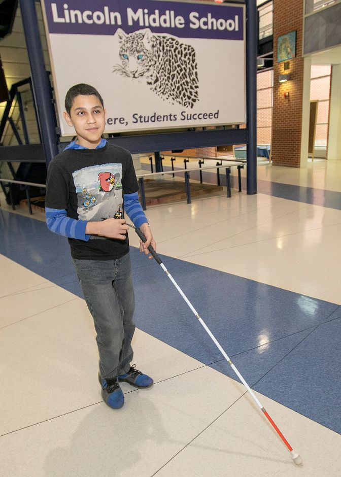 Sixth-grade student Jose Nieves Roman, 12, walks to his occupational therapy room at Lincoln Middle School in Meriden, Tues., Jan. 8, 2019. Dave Zajac, Record-Journal