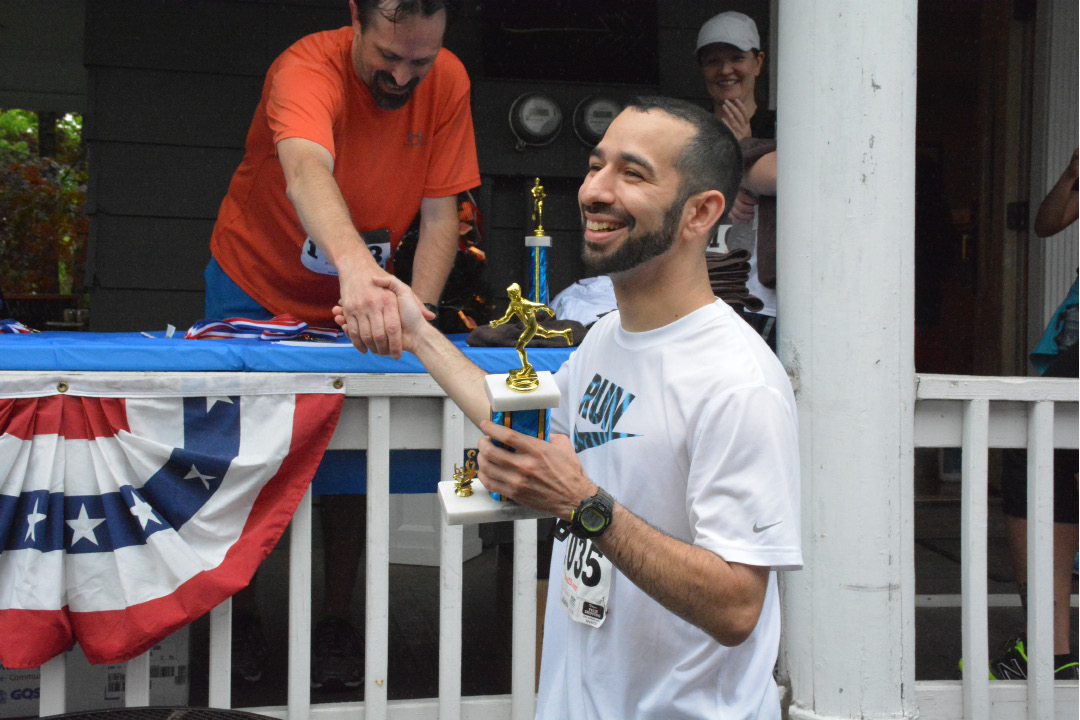 Steve Bucchieri accepting his third place trophy from David Radcliffe. | Ariana D