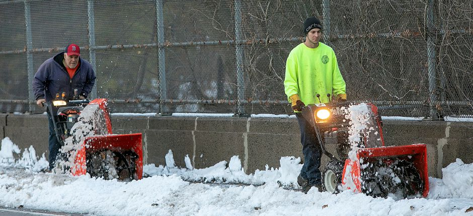 City workers Bob Terapane, left, and Chris Gasior, clear snow from the sidewalk along Paddock Avenue near Thomas Hooker Elementary School in Meriden, Fri. Nov. 16, 2018. Dave Zajac, Record-Journal