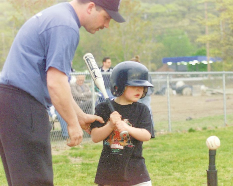 RJ file photo - David Giarratana gives his son David, 6, some pointers during a Wallingford Little League T-ball game May 5, 1999.