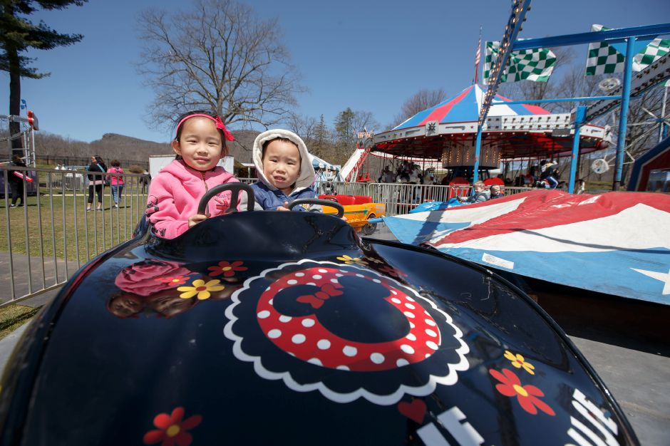 Cayden Chen 4 right and sister Sabrina 6 of Wallingford take a spin in a carnival ride Saturday during the Pre Daffodil Festival weekend at Hubbard Park in Meriden April 21, 2018 | Justin Weekes / Special to the Record-Journal