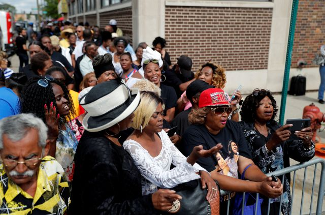 A crowd gathers outside New Bethel Baptist Church as a viewing for Aretha Franklin is held, Thursday, Aug. 30, 2018, in Detroit. Franklin died Aug. 16, 2018 of pancreatic cancer at the age of 76. (AP Photo/Jeff Roberson)