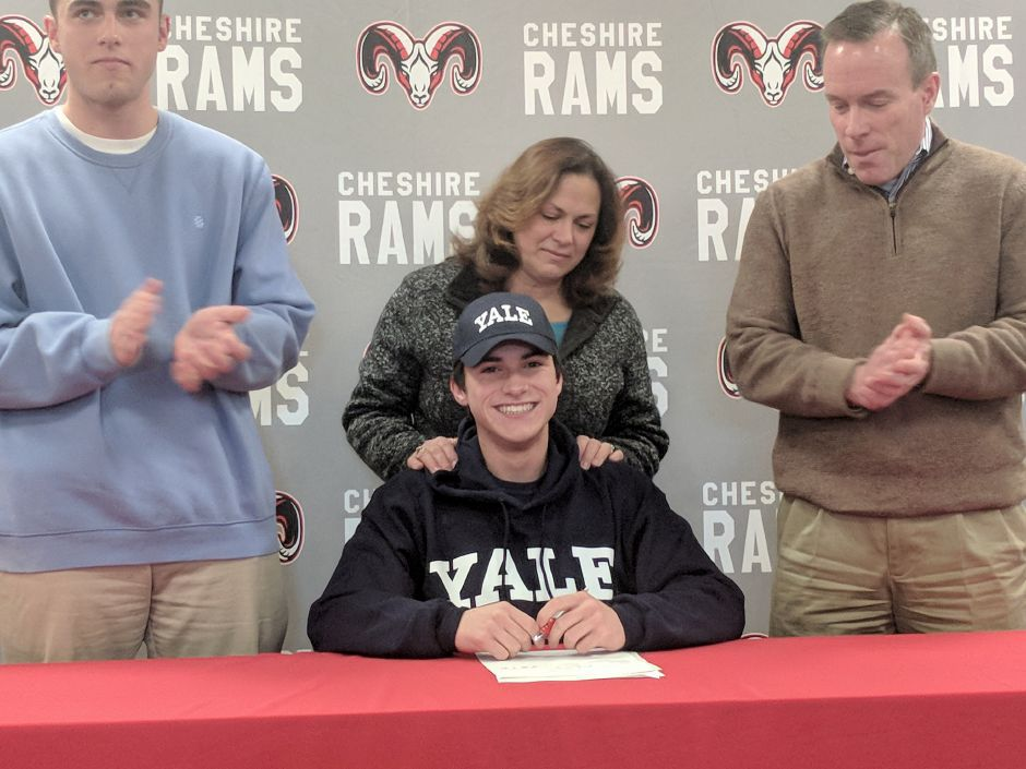 Flanked by his brother Aidan, mother Lisa and father Pete, Cheshire cross country runner Brendan Murray signed a National Letter of Intent with Yale University on Thursday afternoon at Cheshire High. | Joe Boyle / For the Record-Journal