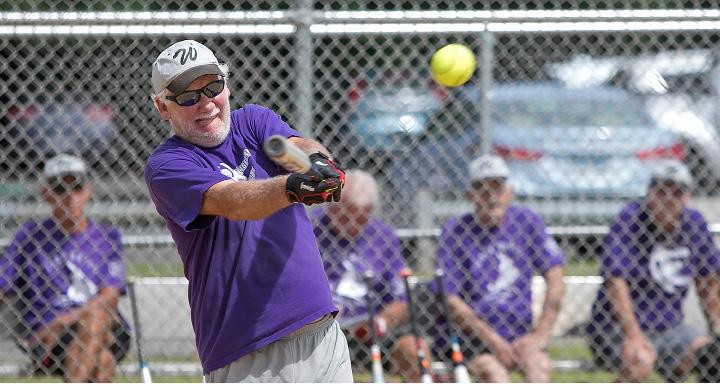 Terry Clark, 73, of Clinton, belts a base hit for the Naturals during a game against the Pirates in the Jack Doyle senior softball league at Pragemann Park in Wallingford, Monday, August 14, 2017. The Naturals defeated the Pirates 15-10. | Dave Zajac, Record-Journal