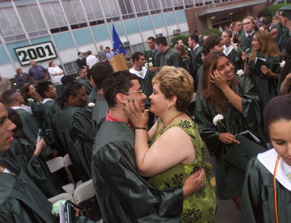 At graduation ceremonies Maloney High School in Meriden. Benny Vazquez, left, gets a kiss from his mother Savina Colon, immediately after the ceremonies.