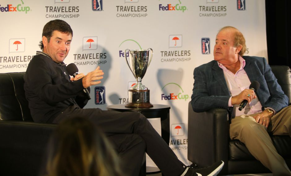 Bubba Watson, left talks with ESPN personality Chris Berman and the assembled media during last month's Travelers Championship Media Day. The defending champ will be in one of the feature groups Thursday and Friday playing with Brooks Koepka and Tony Finau. Spencer Davis, Record Journal