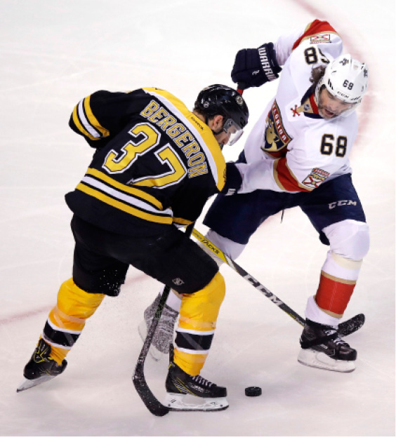 Boston Bruins center Patrice Bergeron (37) and Florida Panthers right wing Jaromir Jagr (68) battle for the puck during the first period of an NHL hockey game in Boston, Monday, Dec. 5, 2016. (AP Photo/Charles Krupa)
