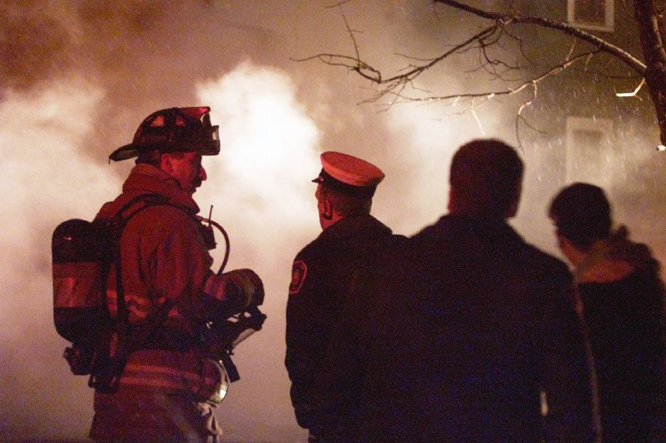 Firefighter Jim Cosenza, left, with Asst. Chief Ray Guest on Grove St. for a house fire Mon., Jan. 7.
