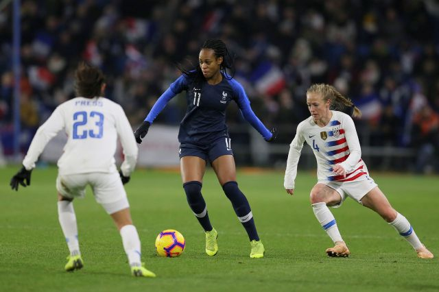 France forward Marie-Antoinette Katoto, centre, vies for the ball with US forward Christen Press, left, and defender Becky Sauerbrunn during a women