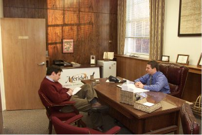 Meriden Mayor Mark Benigni being interviewed Thurs., Jan. 3, 2002 by R-J reporter Mark Peters.
