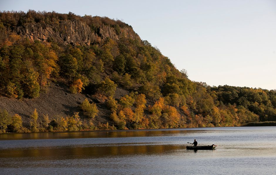 A man maneuvers his boat while fishing scenic Black Pond near the Meriden town line, Thursday, October 12, 2017. | Dave Zajac, Record-Journal