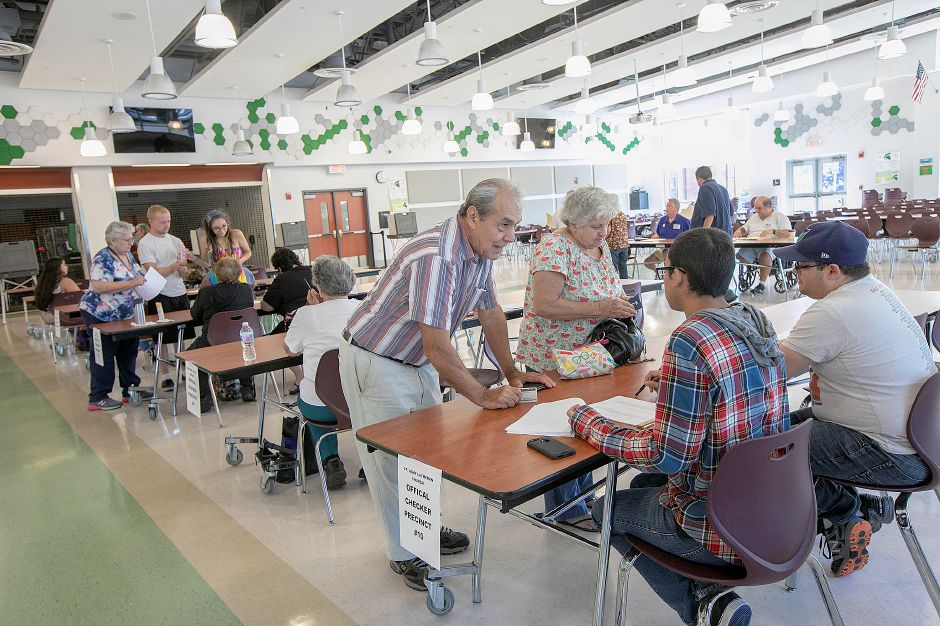 Jose and Catalina Rivera, of Meriden, center, check in before voting at Maloney High School as residents decide whether to send the adopted 2018-19 budget back to the City Council for changes, Wednesday, July 18, 2018. Dave Zajac, Record-Journal