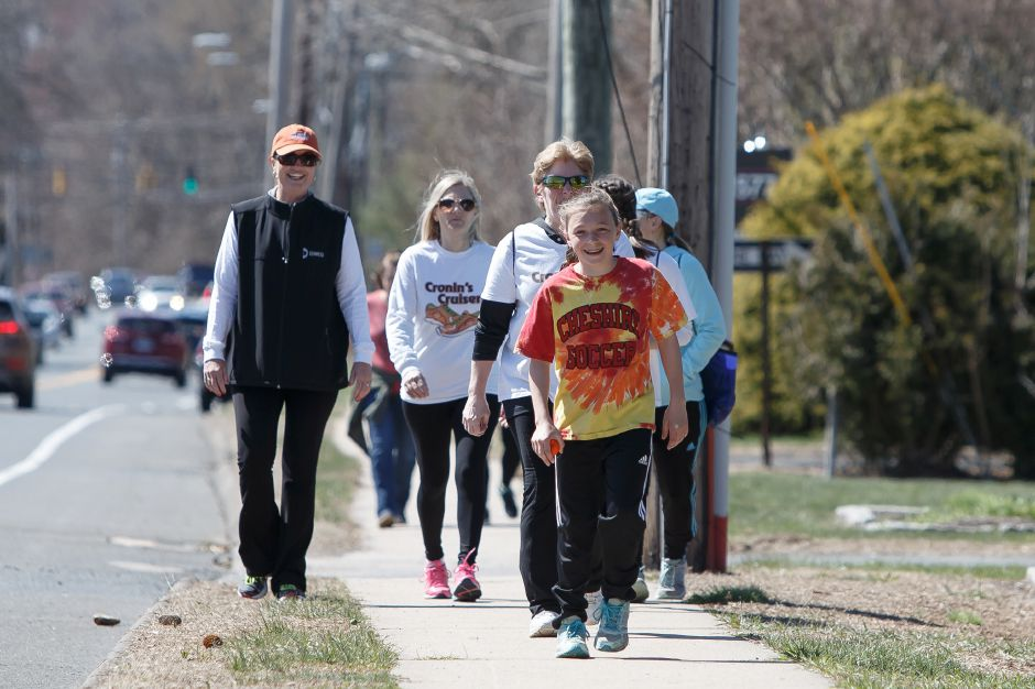 Amber Casner, 12, of Cheshire, leads a group Cronin's Cruisers during the annual Walk MS fundraiser at Cheshire High School.  Justin Weekes, special to the Record-Journal