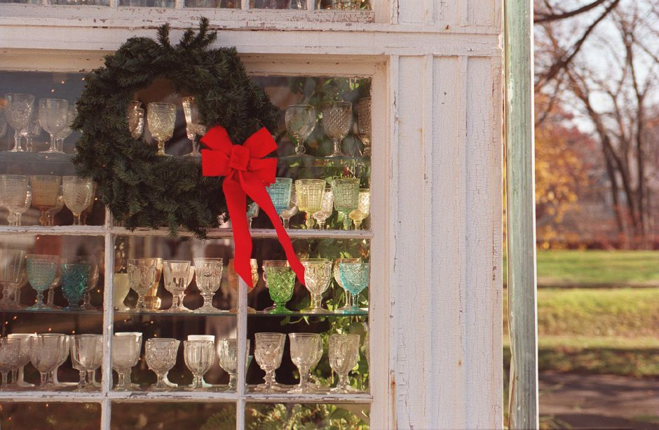 RJ file photo - A Christmas wreath graces the window of glass goblets at the Barnes Museum in Southington, Dec. 1998.