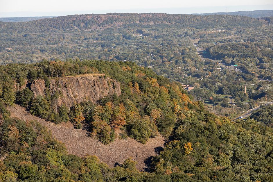 View looking east from Castle Craig in Meriden shows minimal foliage around South Mountain and beyond, Friday, Oct. 12, 2018. Foliage is running about two weeks later than normal in Connecticut according to Christopher Martin, state forester for the Connecticut Department of Energy and Environmental Protection. Dave Zajac, Record-Journal