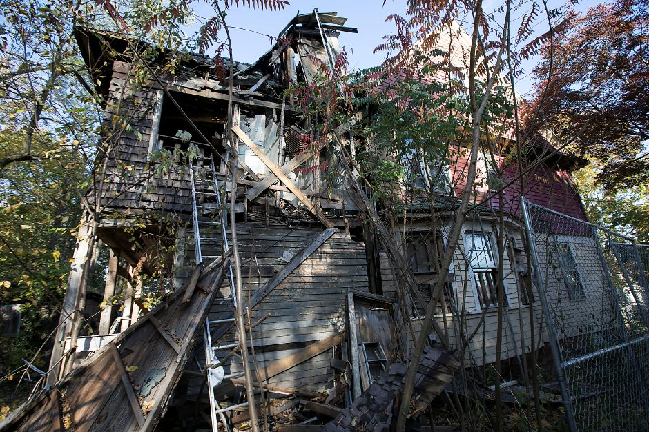 The rear of a dilapidated house at 11 Colony Place in Meriden, Thursday, Nov. 9, 2017. Crews were preparing to demolish one of the city's most decrepit blighted properties when an injunction filed by the homeowner stopped the proverbial wrecking ball in its tracks. | Dave Zajac, Record-Journal