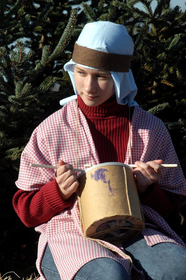 Kristyn Vergauwen plays the drummer boy during the nativity scene at the Francisean Life Center