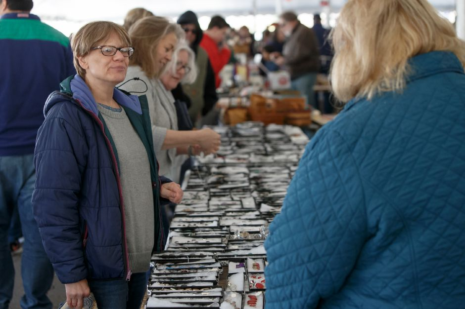 Fran Messina of Meriden talks with Barbara Scully of the Meriden Wallingford Civilan Club fund raiser booth in the tag sale tent Saturday during the Pre Daffodil Festival weekend at Hubbard Park in Meriden April 21, 2018 | Justin Weekes / Special to the Record-Journal
