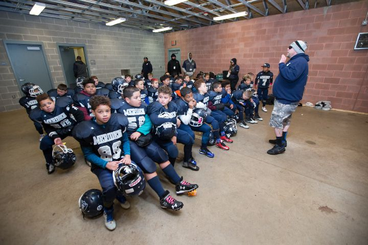 Raiders head coach Karl Harris talks with players at the half Sunday during the New England championship at Falcon Field in Meriden Nov. 20, 2016 | Justin Weekes / For the Record-Journal