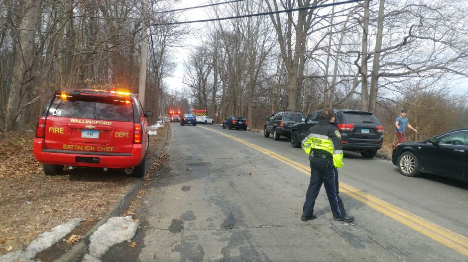 Emergency crews have responded to Highland Avenue in Wallingford after a car struck a tree. | Devin Leith-Yessian, Record-Journal