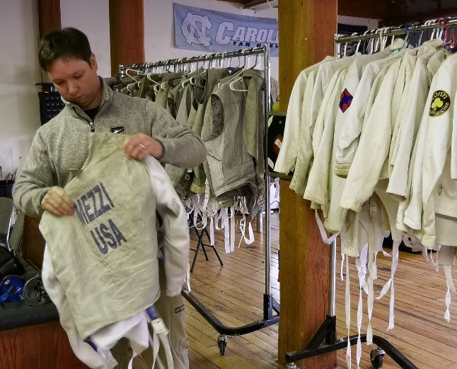 Kyle Mezzi, owner and coach, picks up a fencing uniform at Silver City Fencing Club, 340 Quinnipiac St., Wallingford. |Ashley Kus, Record-Journal