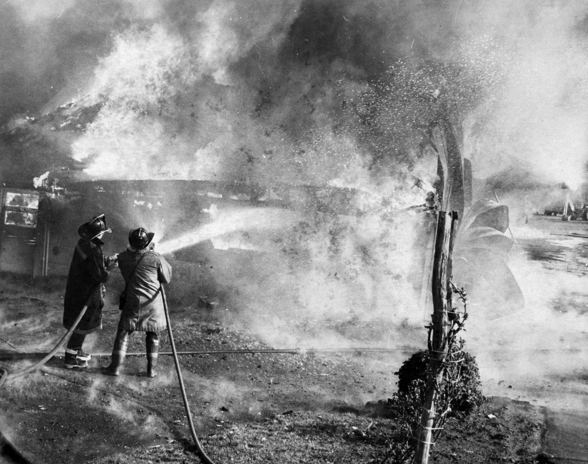 Meriden firefighters on the scene of the A-1 Rentals fire in 1974. | Record-Journal archives