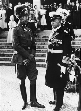 Attending the funeral of German pilot Reinhold Poss on August 29, 1933 in Berlin, Germany are former German crown prince Wilhelm of Prussia and Admiral Erich Reader, right. (AP Photo)