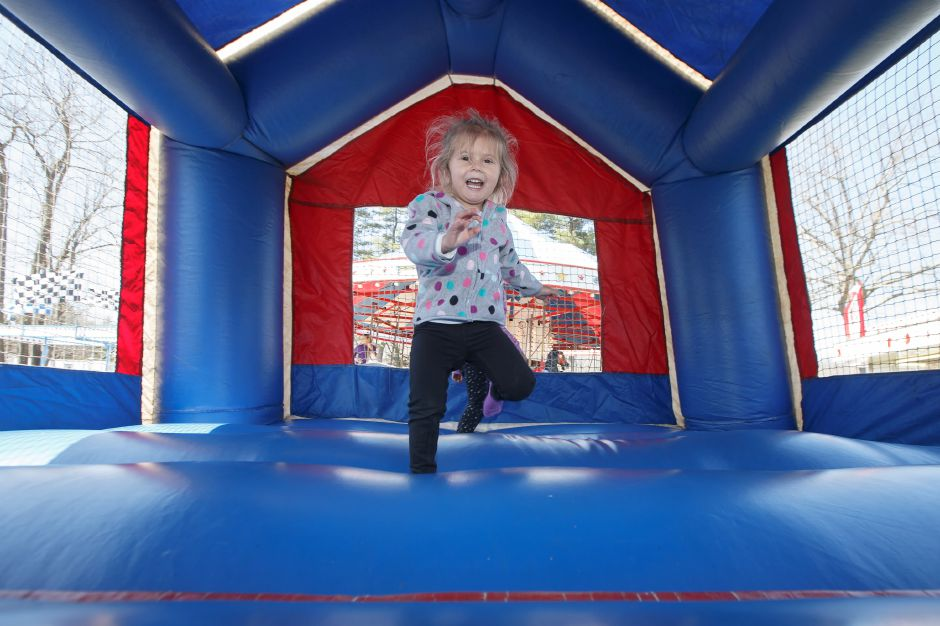 Summer Belle 3 of Southington enjoys the bounce house Saturday during the Pre Daffodil Festival weekend at Hubbard Park in Meriden April 21, 2018 | Justin Weekes / Special to the Record-Journal