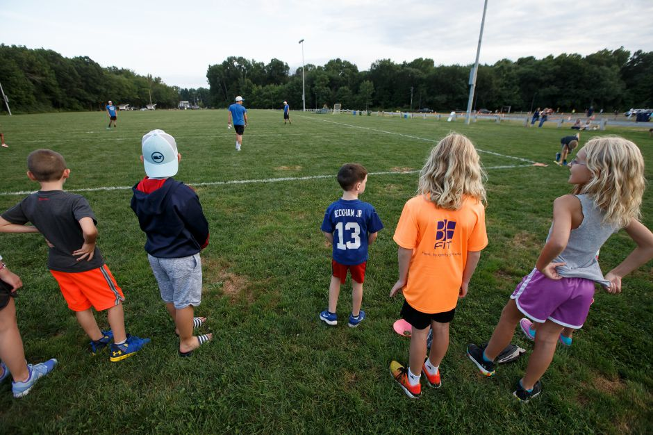Kids wait their turn to bat in a whiffle ball game with the Southington baseball team Saturday at the Southington Drive In hosted by Bread for Life in Southington September 1, 2018 | Justin Weekes / Special to the Record-Journal