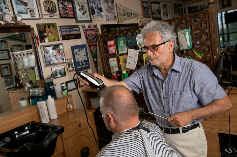 "Barber Prisco ""Pic"" DeLuca gives a haircut to longtime customer Ken Fahey at Haircraft Hair Salon, at 1259 E. Main St. in Meriden. DeLuca is retiring and closing the business after 46 years. Dave Zajac, Record-Journal"