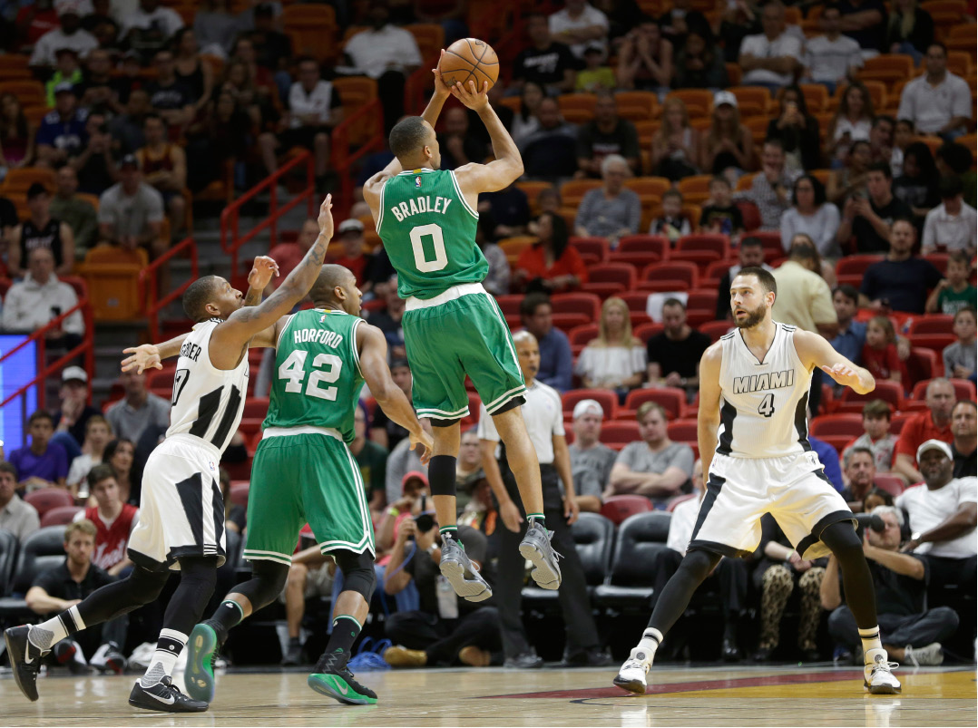 Boston Celtics guard Avery Bradley (0) prepares to shoot against the Miami Heat in the first half of an NBA basketball game, Sunday, Dec. 18, 2016, in Miami. (AP Photo/Alan Diaz)