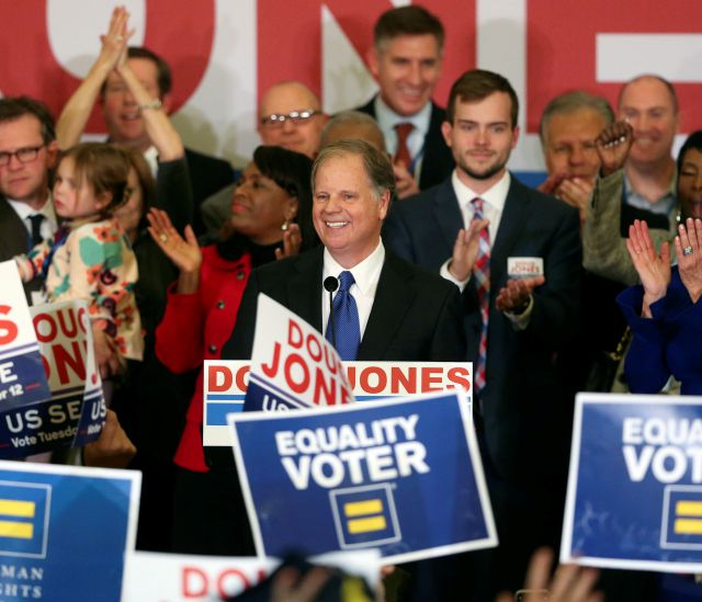 Democrat Doug Jones speaks Tuesday, Dec. 12, 2017, in Birmingham, Ala. In a stunning victory aided by scandal, Jones won Alabama